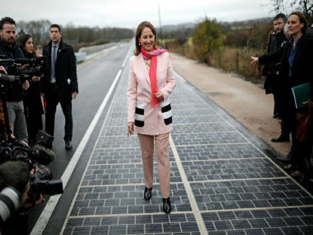 In 1st, road paved with solar panels powers French town