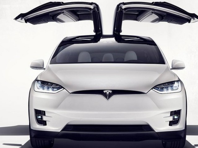 Tesla Unveils Model X Electric Family Car With Falcon Wing Doors And Bio Weapon Defense Mode