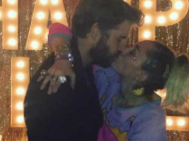 Miley Cyrus And Liam Hemsworth Smooch On NYE, And The World Notices