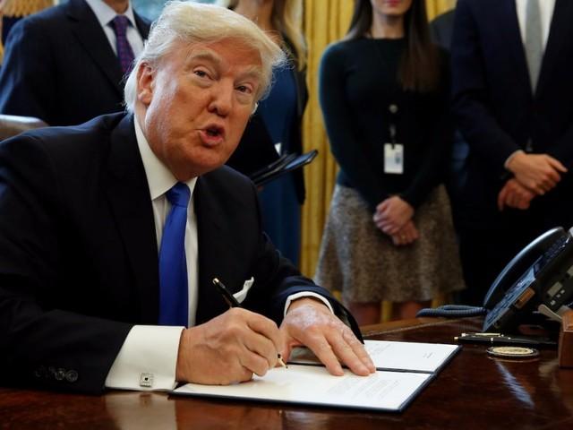 Trump Signs Travel Ban Order