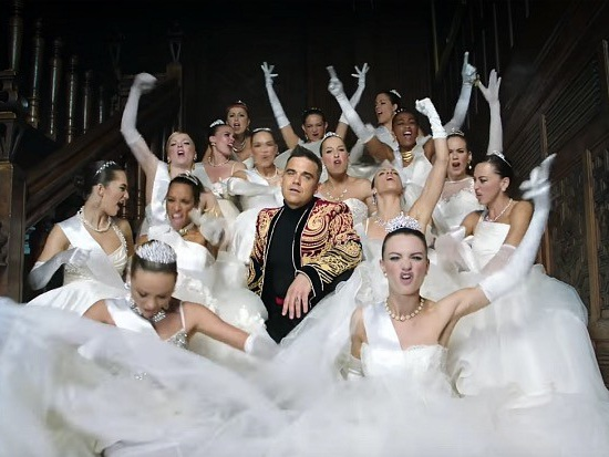 "Robbie Williams Prefers To ""Party Like A Russian"": Watch The Video"