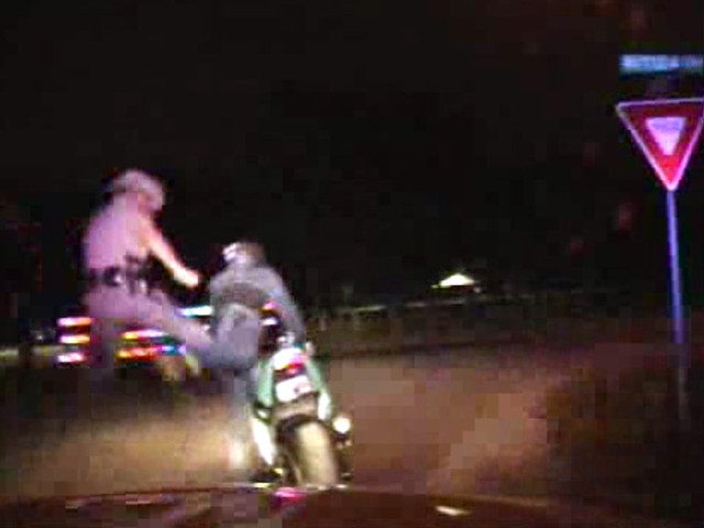 Video shows DPS trooper karate kick suspect off his motorcycle