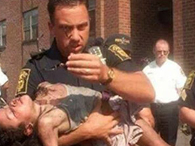 Cop Who Saved 5-Year-Old From Fire Watches Her Graduation 18 Years Later