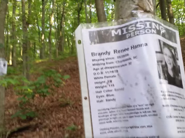 Video: Man Discovers A Bizarre Campsite In The Middle Of The Woods…Surrounded By Pictures Of Missing Persons